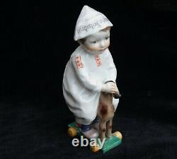 Meissen circa 1910 model of a boy riding a hobby horse in perfect condition