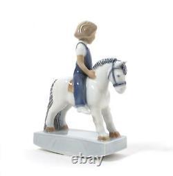 Porcelain figurine Boy on rocking horse. Denmark, Royal Copenhagen #5651